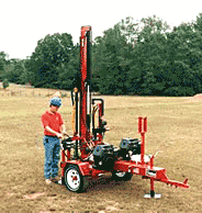 A small trailer-mounted drilling rig