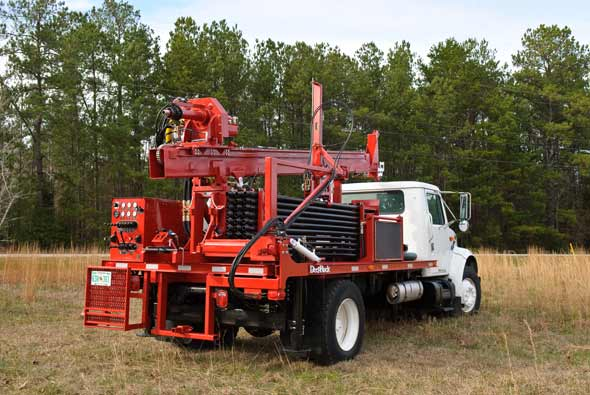 A DR150 Water Well Drilling Rig with a full load of drill rods ready for work